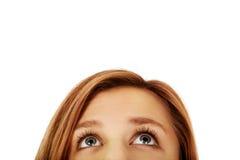 Ojos adolescentes de la mujer que miran para arriba Fotografía de archivo libre de regalías