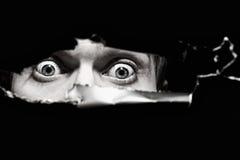 Ojos asustadizos de un hombre Imagen de archivo