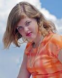 Ojos azules hermosos en naranja Foto de archivo libre de regalías