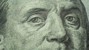 Ojos de Benjamin Franklin 100 dólares de primer de la nota Foto de archivo libre de regalías
