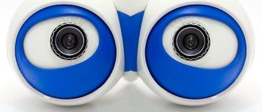 Ojos de la robusteza. Una mirada robótica blanca de los ojos Fotos de archivo