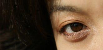 Ojos de una mujer asiática joven Imágenes de archivo libres de regalías