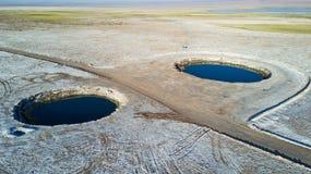 Ojos del Salar Ögon av den salta pannan fotografering för bildbyråer