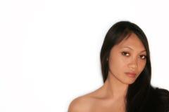 Ojos marrones tristes de una mujer Foto de archivo libre de regalías