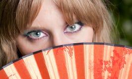 Ojos y un ventilador Imágenes de archivo libres de regalías