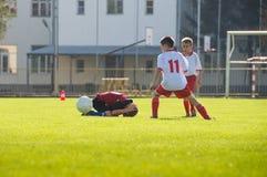 Ojust spel i fotbollsmatch Royaltyfri Foto