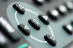 OK. An OK button on a black TV remote Stock Image