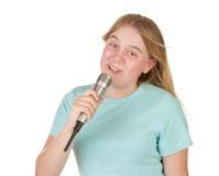 女孩卡拉OK演唱唱歌少年 免版税库存照片