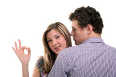OK. Young beautiful girl showing OK sign near her boyfriend Royalty Free Stock Images