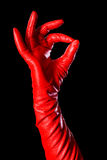 OK!. Hand in red glove on the black background showing that everything is OK Stock Photo