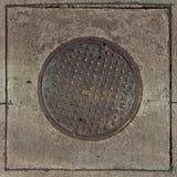 okładkowy rynsztokowy manhole Fotografia Stock