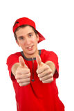 Ok, alright. Smiling handsome boy with red t-shirt over a white background. Success gesture and two finger on focus royalty free stock photography