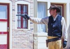 OK Corral gunfight. TOMBSTONE , ARIZONA - AUG 09 : Actor takes part  in the Re-enactment of the OK Corral gunfight in Tombstone , Arizona on August 09 2014 Stock Photos