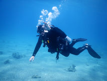 OK de geste de plongeur Photos stock