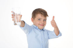 Ok it is fresh. Young boy says ok holding a glass of water Stock Images