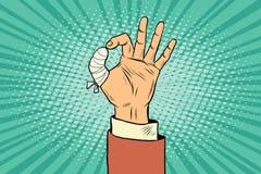 OK gesture bandaged finger Royalty Free Stock Photo
