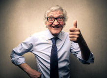 Ok gesture. Elderly man business doing ok gesture royalty free stock photos