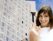 Ok girl against business building Royalty Free Stock Image