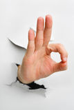 Ok hand sign. Came from cracked wall - one of the breakthrough series stock image
