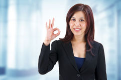 OK hand sign. Mixed race Mid Adult Asian showing ok hand sign in work place stock photo