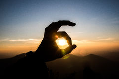 Ok hand sign silhouette at sunset. Ok hand sign silhouette at sunset Stock Photo
