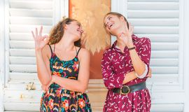 OK hand sing, We approve. Two young best friend giving the OK hand sign and approving stock photography