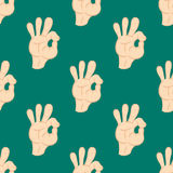 Ok hands success gesture okey yes agreement signal seamless pattern human agree best approval vector. Stock Photo