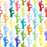 Ok hands success gesture okey yes agreement signal seamless pattern human agree best approval vector. Stock Photos