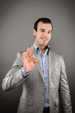 OK. Image of a young business man giving the OK sign Royalty Free Stock Images