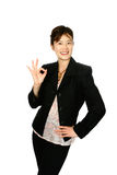 ''OK'' Japanese businesswoman. Young attractive Japanese businesswoman giving a gesture of '' OK '', smartly attired, isolated on white Royalty Free Stock Photography
