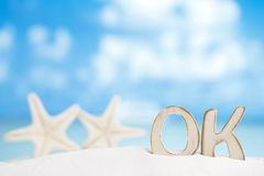 OK message with two starfish on Florida white sand beach Royalty Free Stock Images