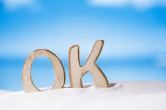 OK message on white sand beach Royalty Free Stock Photography