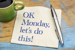 OK Monday, let us do this!. OK Monday, let`s do this! - handwriting on a napkin with a cup of espresso coffee royalty free stock photography