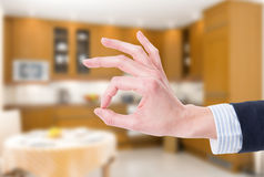 Ok or perfect gesture on house indoor background Stock Photography