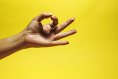 OK sign. An image of a hand signalling the ok sign stock photo