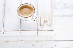 OK sign with espresso coffee in cup and K letter Royalty Free Stock Image
