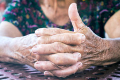 Ok sign. Selective focus on the front fingers on old female hands with ok sign Royalty Free Stock Images