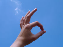 Ok Sign with sky background. Ok Sign (hand sign) with sky background Royalty Free Stock Image