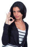 Ok symbol. With her hand young girl doing the ok symbol Royalty Free Stock Photography
