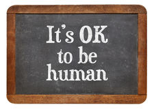 It is OK to be human - blackboard sign. It is OK to be human - white chalk text on a vintage slate blackboard Royalty Free Stock Photos