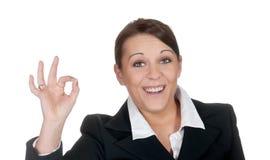 ok visande tecken för affärskvinna Arkivfoto