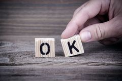 Ok. Wooden letters on the office desk, informative and communication background Royalty Free Stock Photography