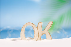 OK word wooden letters with  ocean , beach and seascape Royalty Free Stock Photography