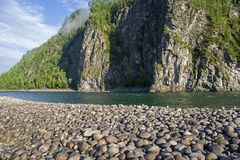 The Oka Sayanskaya River. Siberia, Russia. The Oka Sayanskaya River in the Orkho-Bom gorge. Sunny summer day. Buryatia, Siberia, Russia Stock Images