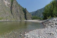 The Oka Sayanskaya River. Siberia, Russia. The Oka Sayanskaya River in the Orkho-Bom gorge. Sunny summer day. Buryatia, Siberia, Russia Stock Image