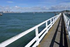 Okahu bay wharf with Auckland skyline Royalty Free Stock Photos