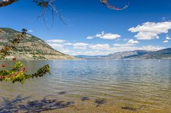 Okanagan Lake in Penticton on a Clear Summer Day. Beautiful Okanagan Lake under Blue Sky from the Shore in Penticton on a Clear Summer Day stock images