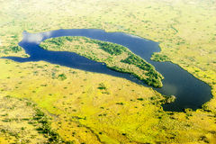 The Okavango Delta seen from heli. The meander in the Okavango Delta, Botswana, forms a little island Royalty Free Stock Image