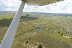 Okavango Delta viewed from a plane. The Okavango Delta viewed from a plane. The views are astonishing, lush green as far as the eye can see, water and abundant Stock Photo