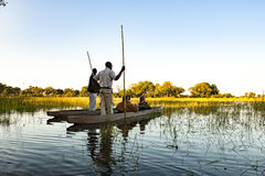Okavango Trip with Dugout Canoe in Botswana Stock Images